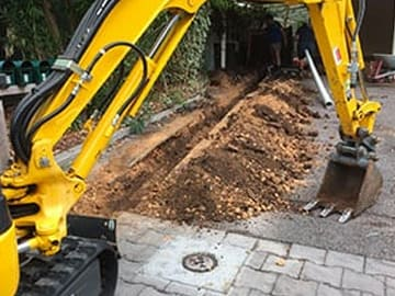 Using 5-Tonne Excavator hired for trenching work