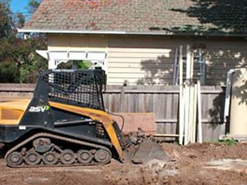 Dial A Digger Contractor Levelling Backyard For Lawn Installation