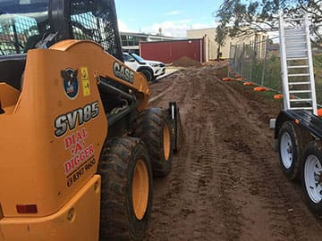 Skid Steer Doing Excavation Work